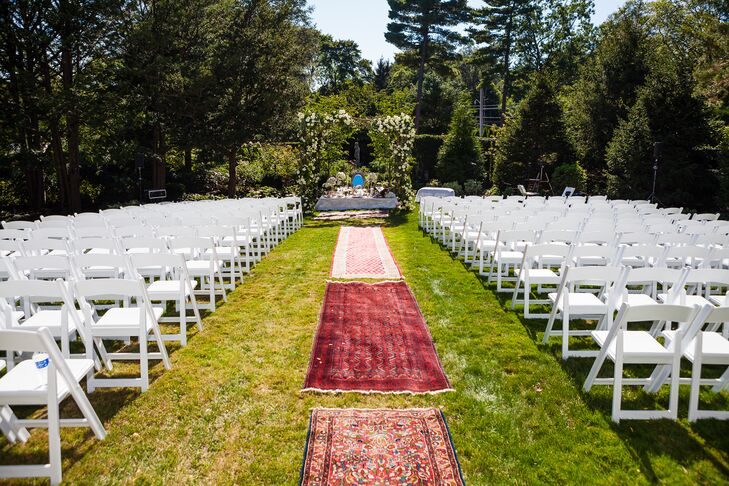 Each aspect of the ceremony, including the decor, spoke to the couple's rich cultural heritage. As a nod to Simin's Persian roots, Nicholas and Simin lined the lush, grassy aisle with Persian rugs in deep shades of red.