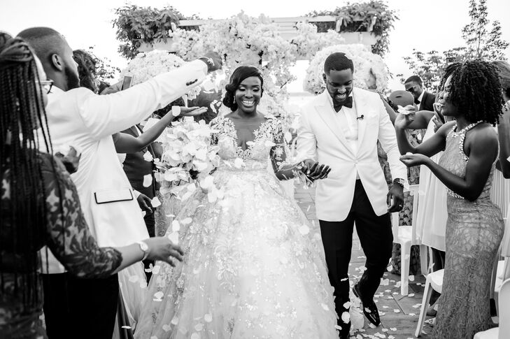 """As Nkenna and Ekwere made their way up the aisle after saying """"I do,"""" their friends and family members showered them with fragrant white rose petals."""