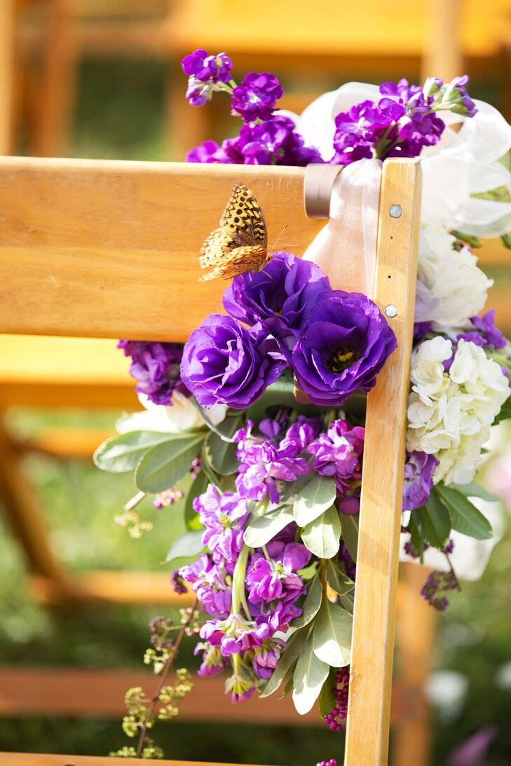 At the ceremony site, purple and cream flowers adorned each row of chairs lining the aisle.