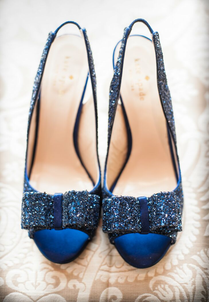 """Lauren's """"something blue"""" was her crystal-encrusted shoes. """"With everything being so classic, I could be a little wild underneath,"""" she says. """"And they matched the bridesmaid dresses and navy décor."""""""