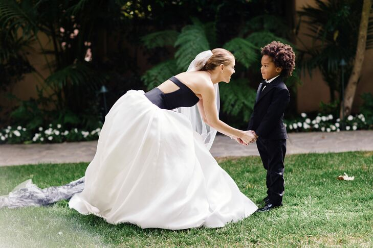 Brittney's cousin was the ring bearer; he wore a black tux and carried the rings down the aisle in a silver box.