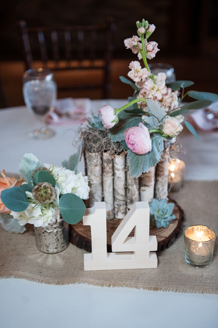 The reception tables were topped with wooden rounds and little bark-decorated vases filled with pink ranunculus, blush sweet peas and mint dusty miller. Mercury glass and candles added plenty of romance to the space.