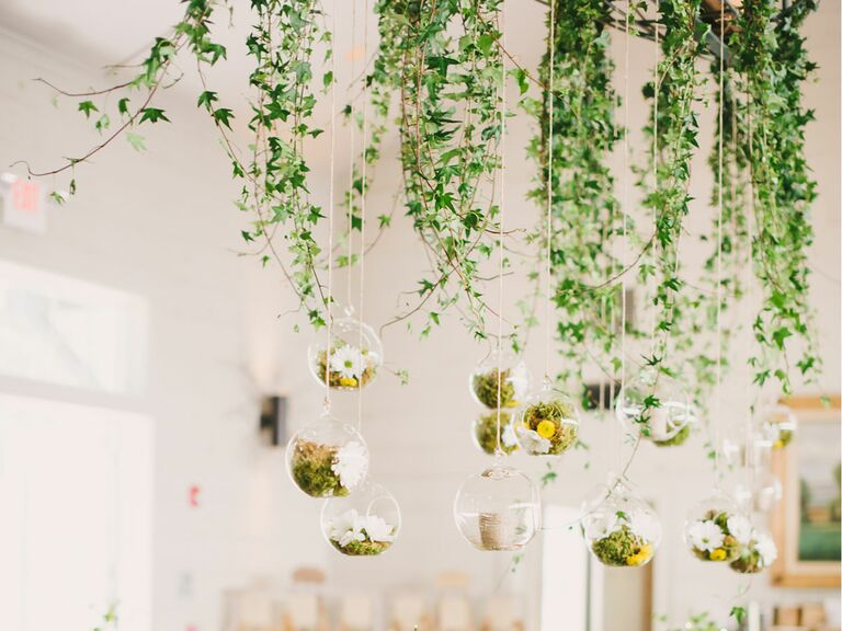 Hanging flowers with rose and anemone centerpieces for a destination wedding