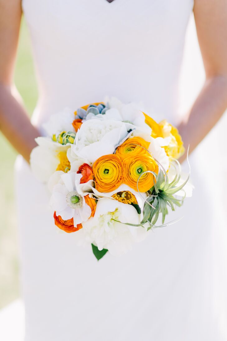 Yakuza carried a compact bouquet of white peonies, yellow ranunculus, air plants and succulents for her walk down the aisle.