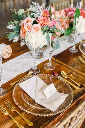 Gold-Rimmed Dinner Plates and Flatware