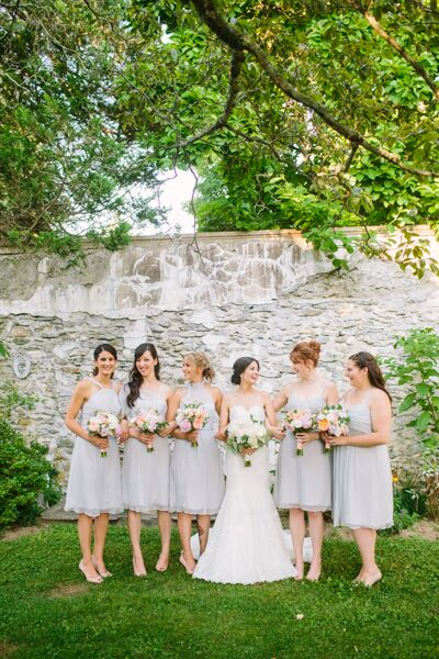 Wanting an elegant vintage feel for the wedding, Erica had her bridesmaids don classic cocktail-style dresses in airy chiffon fabric. They were able to choose a style that best suited their sartorial style and personalities. And with a garden-inspired theme, the gown's pale lavender hue was a perfect fit.