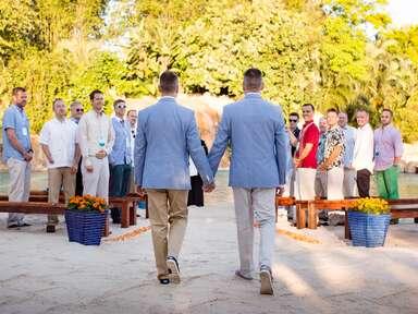 Two grooms beach wedding
