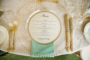 Gold-Beaded Clear Charger with Gold Flatware