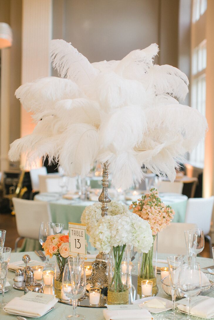 Each of the reception tables featured a unique Gatsby-inspired centerpiece, ranging from cascading feathers to subtle gold bud vases filled with peach and ivory blooms.