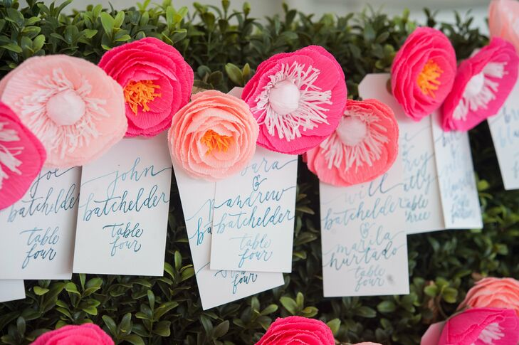 """""""One funny thing that we didn't plan for was many of the male guests ended up putting the escort card flowers in their shirt or suit pockets which created a fun pop of unexpected color throughout the evening!"""" says Katey."""