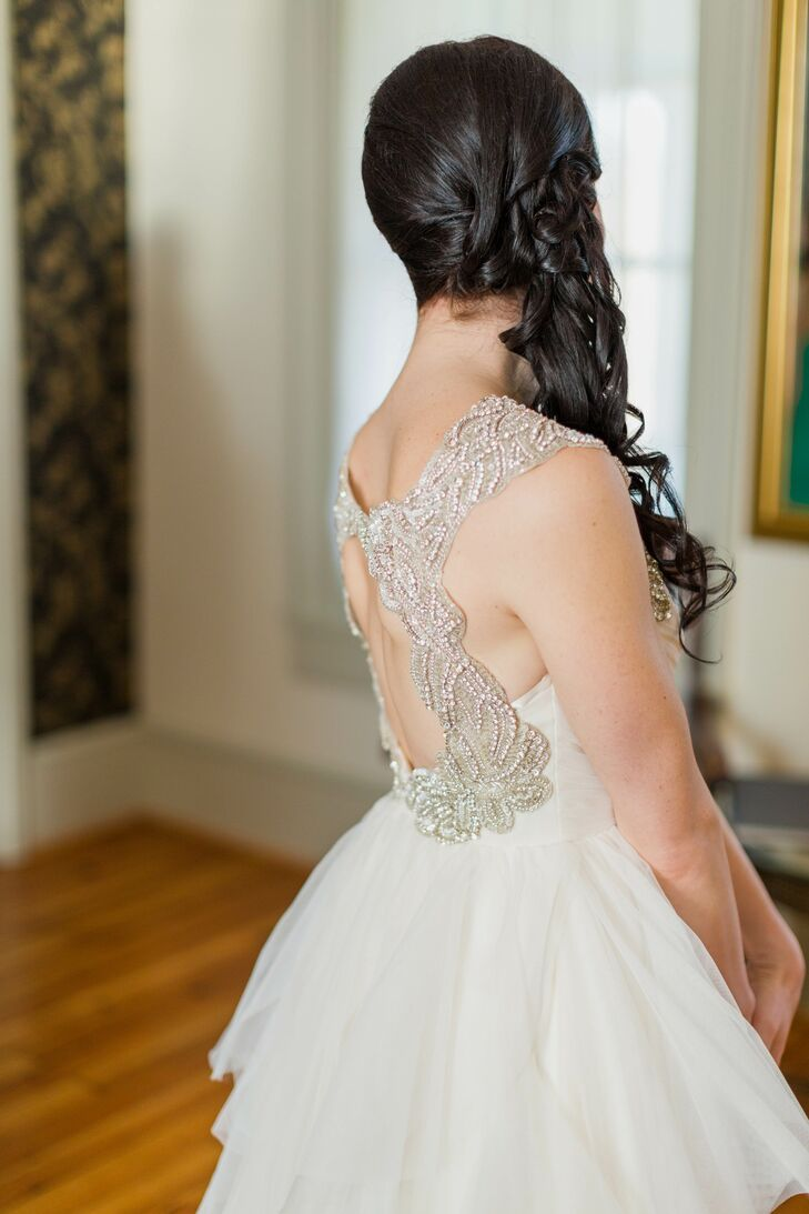 """""""My dress was a gorgeous ivory Haley Paige A-line gown,"""" Chelsea says. """"It had a keyhole back, which, along with the straps, was encrusted with crystals. The train had soft ruffles -- it was so me!"""" She wore her hair in a soft, braided side-swiped updo, so the detailing on the back would show."""