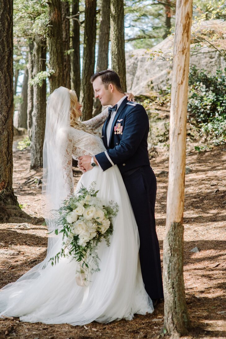 """Woodland romance sums up our wedding theme,"" says Vanessa, whose long-sleeve lace ball gown was a perfect match for Jonathon's military dress blues."