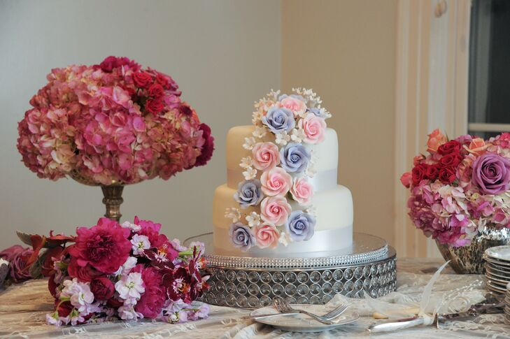 Before Juliana and Scott spent the night dancing to a DJ from Our DJ Rocks, they served their guests cupcakes accented in silver and lavender as well as a two-tier white wedding cake with cascading sugar flowers.
