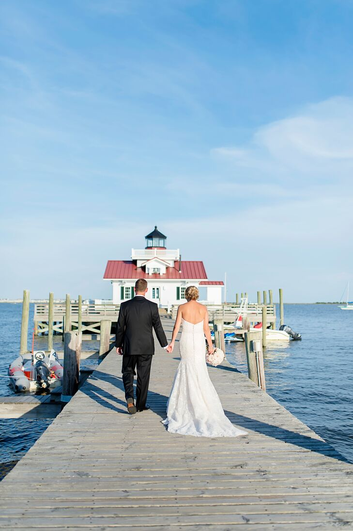 Situated on the Pirate's Cove Marina in Manteo, North Carolina, fishing boats and ocean views created the backdrop for Caroline and Brian's wedding venue. The scenic Outer Banks created a resort feel for the wedding of these North Carolina natives.