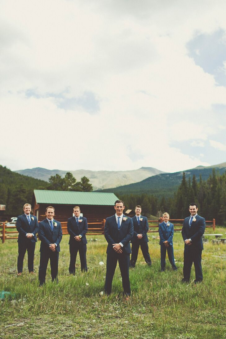 The groomsmen wore textured navy Jos A. Banks suits with black and white checkered shirts and blue ties.