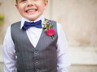 Ring bearer with boutineer and bowtie