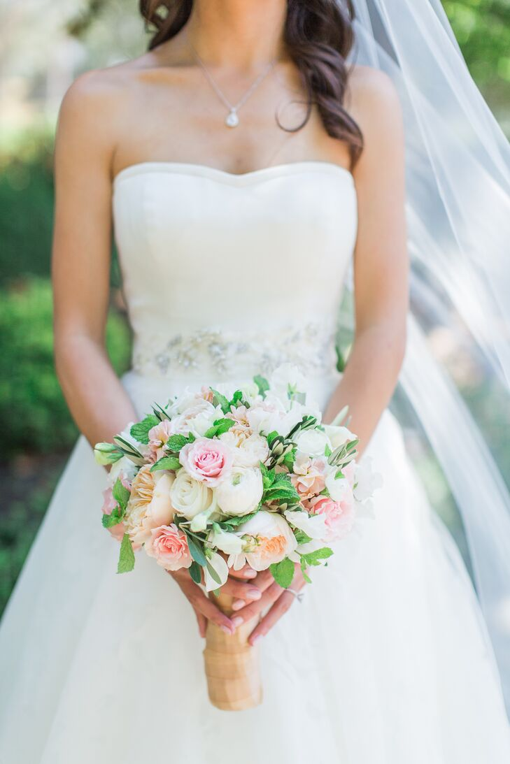 Kristina carried a bouquet of crisp white orchids with touches of leafy greenery.