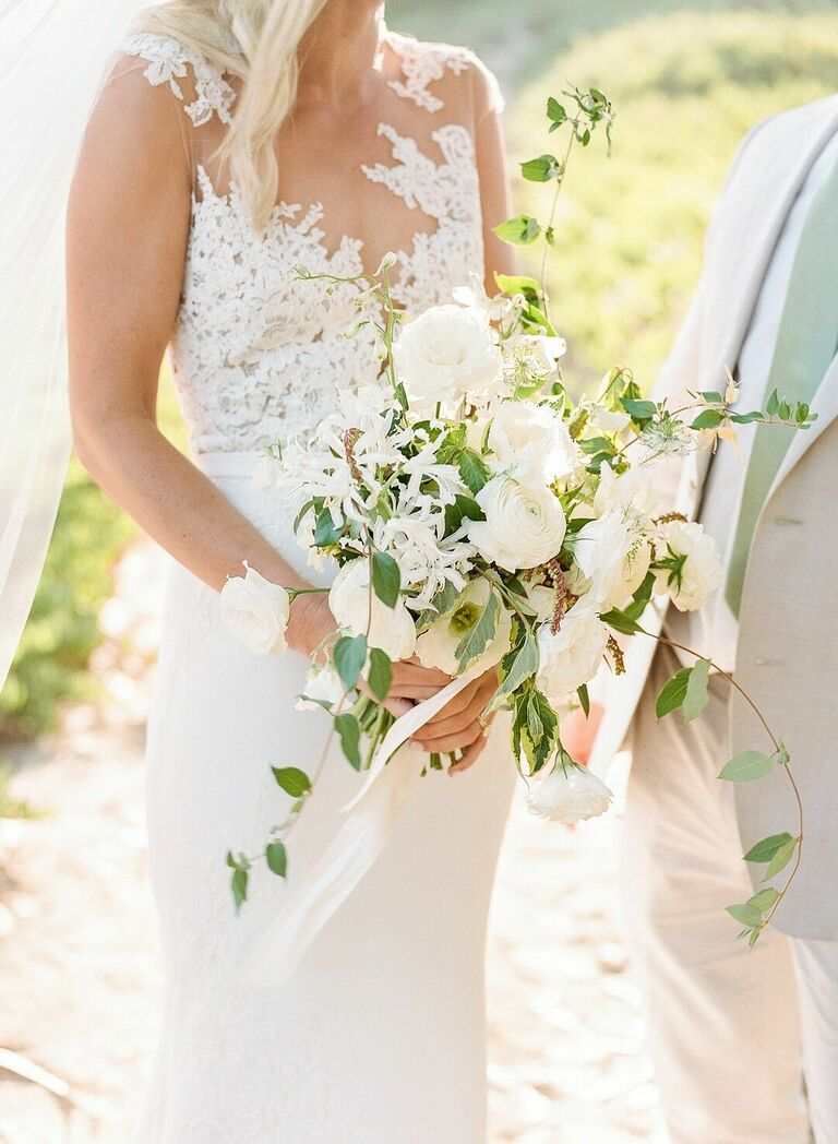 Cascading white bouquet with roses and ranunculus