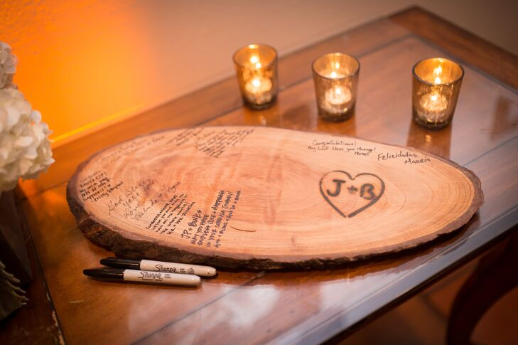 With a love for the outdoors, Bianca and JP substituted a traditional guest book for a rustic wooden slab. Friends and family members were asked to cover it with well-wishes and advice.