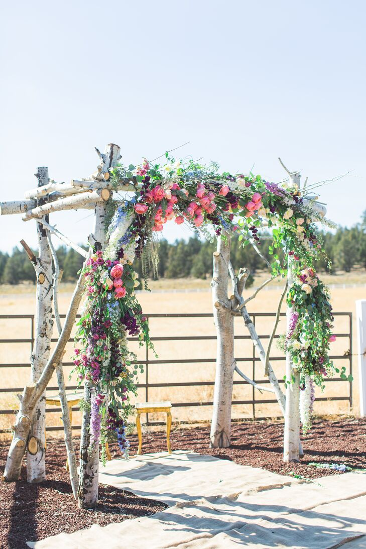 A family friend helped craft the wedding arch with thick alder branches, eucalyptus and pink blossoms.
