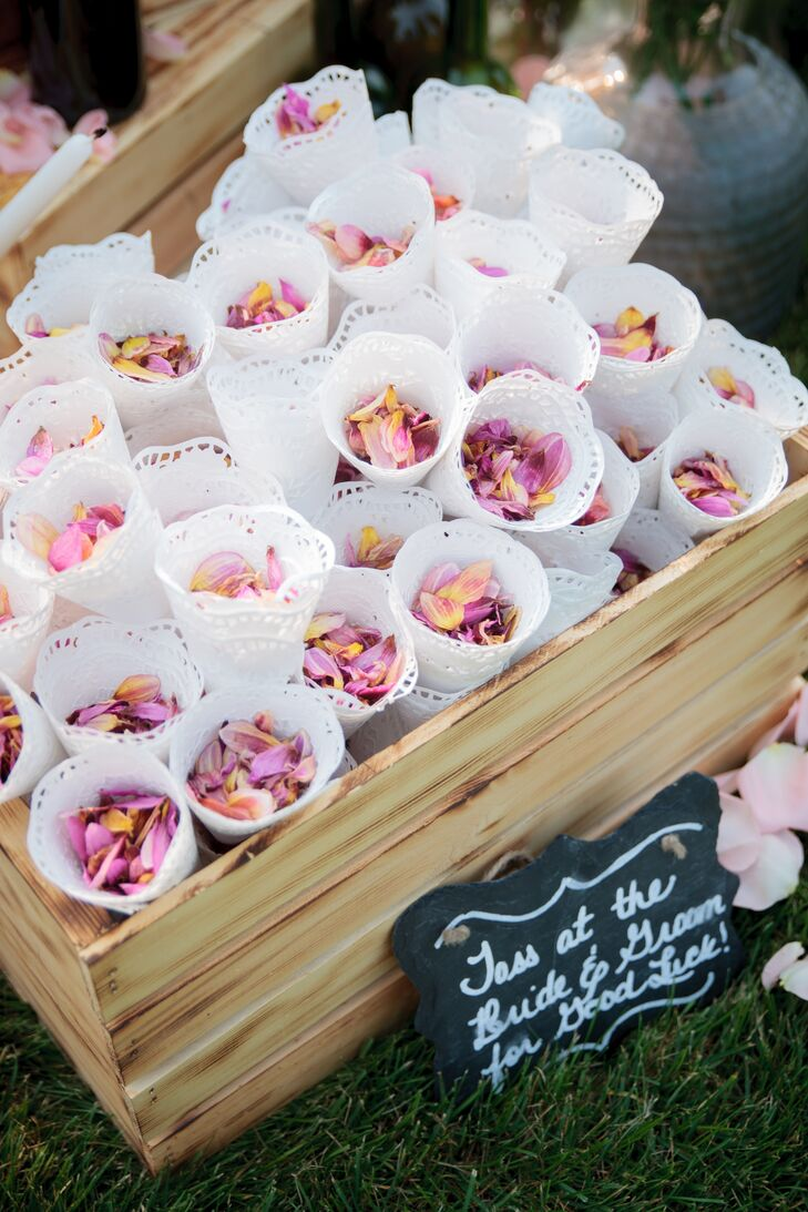 Pink rose petals were gathered in white doily cones to throw at the couple as they exited their ceremony.