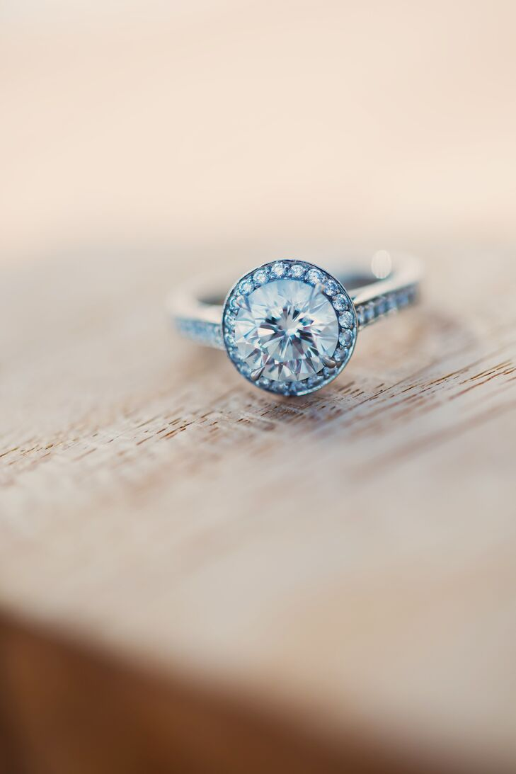 When Andrew proposed to Galin, in full clown gear, he presented her with a round cut diamond in a halo setting from Tiffany & Co.