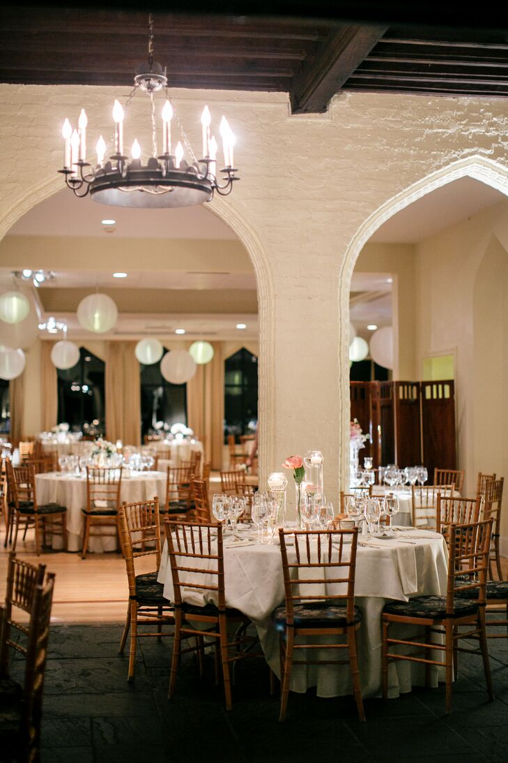 The reception was held indoors at Aldie Mansion. The venue, with its 1920s style, had candelabra chandeliers and beautiful arches throughout the hall.