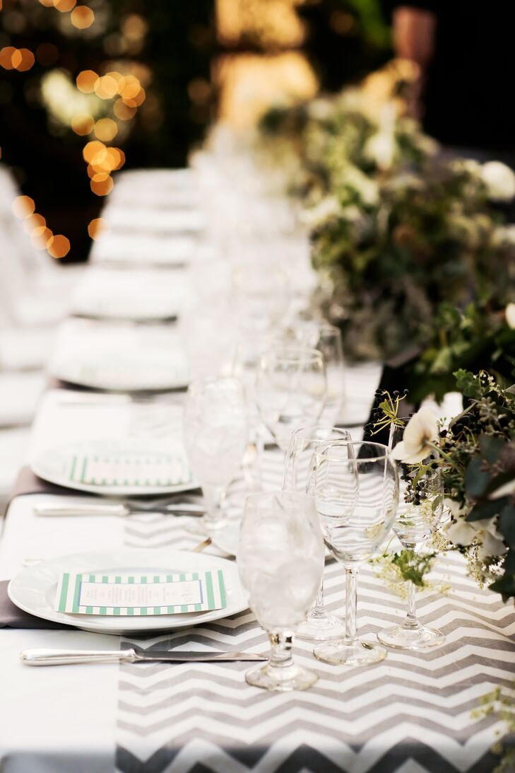 A chevron runner adorned the long banquet table at the greenhouse reception at La Caille in Sandy, Utah. The table was topped with dense succulent centerpieces.