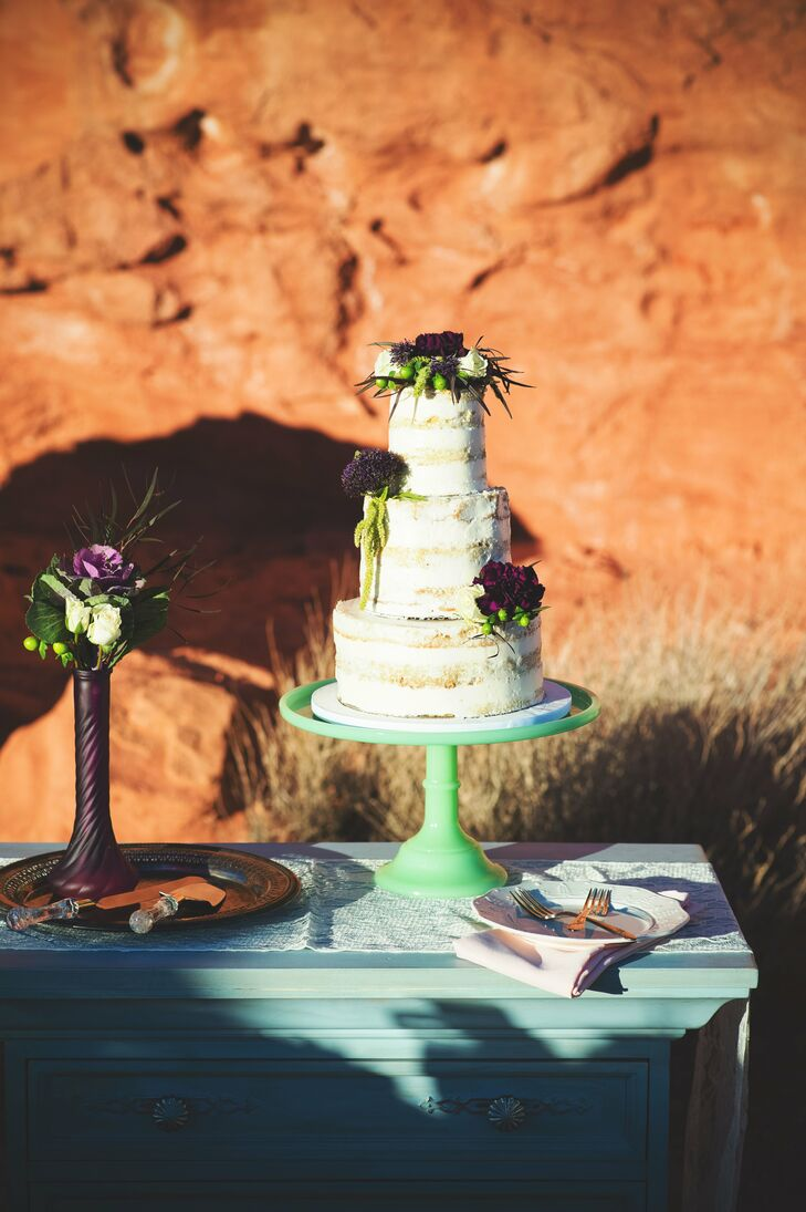 "Peridot Sweets created the rustic three-layer naked cake, which was set on a vintage mint green stand and topped with vibrant purple blossoms. ""We wanted the cake to be minimalist, so it was mostly bare, but it was so beautiful that it out-shined any decoration that could possibly be added to it,"" Genesis says."