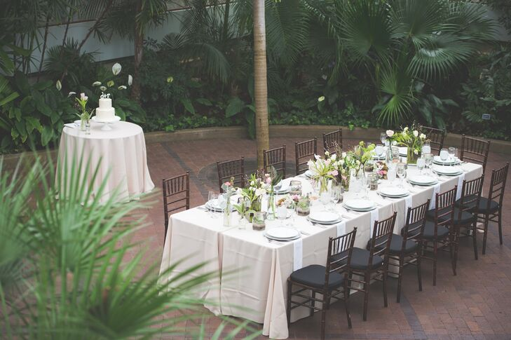 """""""Our ceremony and reception was in the Palm House of the Conservatory, and the foliage there is intense,"""" says Rebecca. """"So the color palette was kept to muted blush tones to ensure it really stood out from the background."""""""