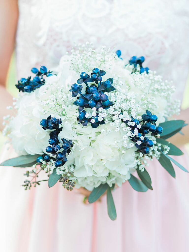Blue and white wedding bouquet with hydrangea, baby's breath and berries