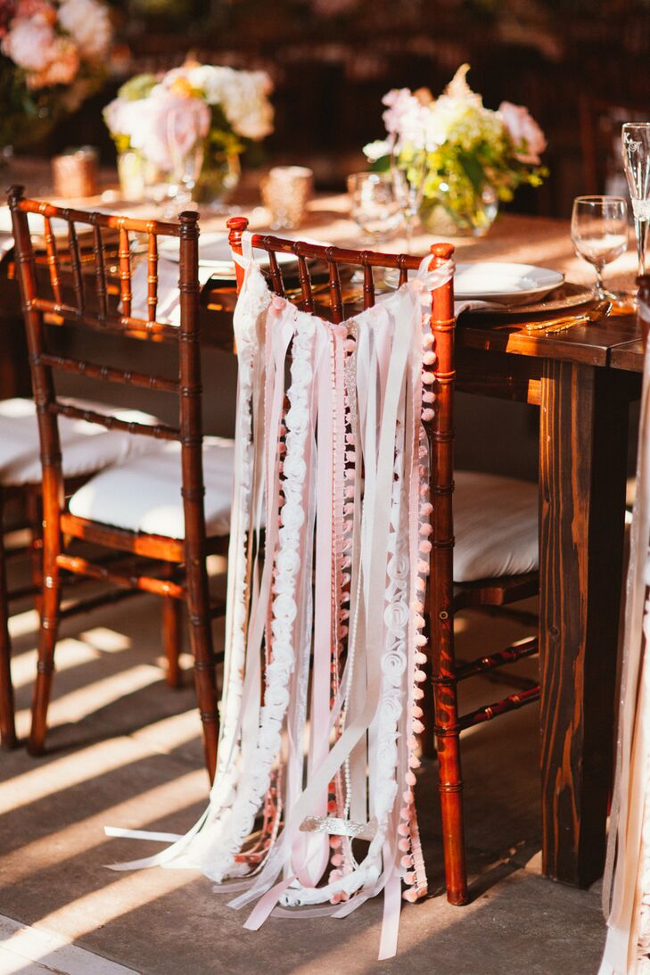No detail was overlooked when it came to the decor — even the reception chairs. To set their seats apart from the rest, Katherine handmade ribbon bunting for the back of the newlywed chairs, which perfectly reflected the day's whimsical, romantic feel.