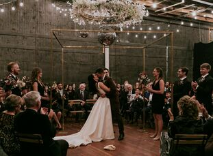 "When planning their wedding, Lara Steele and Jacob Rosen wanted a ""goth meets industrial meets disco vibe with a splash of Burning Man thrown in,"" the"