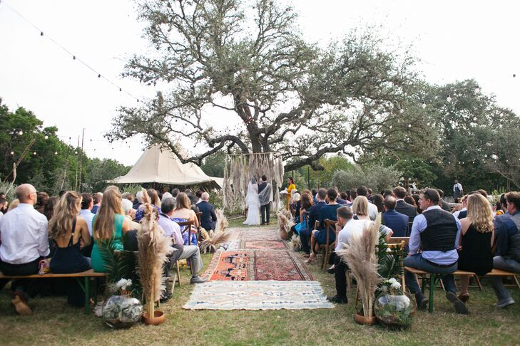Ceremony with Rugs Down Aisle in Driftwood, Texas