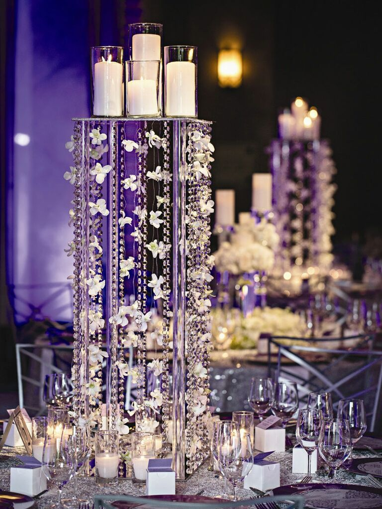 Glamorous wedding centerpiece with candles and garlands