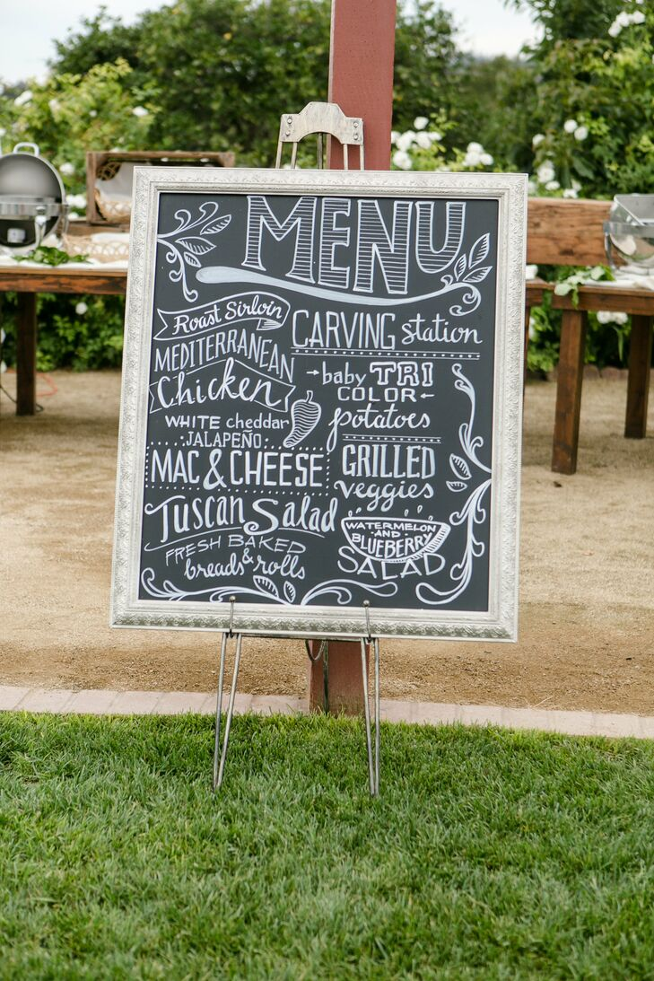 A local artist created this design for their reception's chalkboard menu. He also did the typography on Allie and Adam's bar menu and on the sign for their wedding's hashtag.
