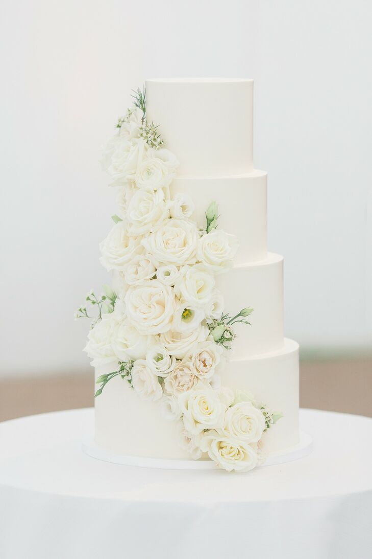 Luxurious Tiered Wedding Cake with Fondant and Flowers