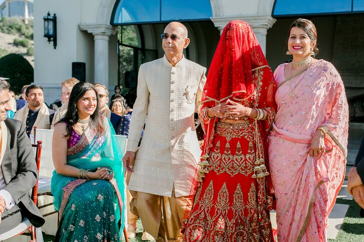 Bride in Tradition Indian Attire Escort by Parents