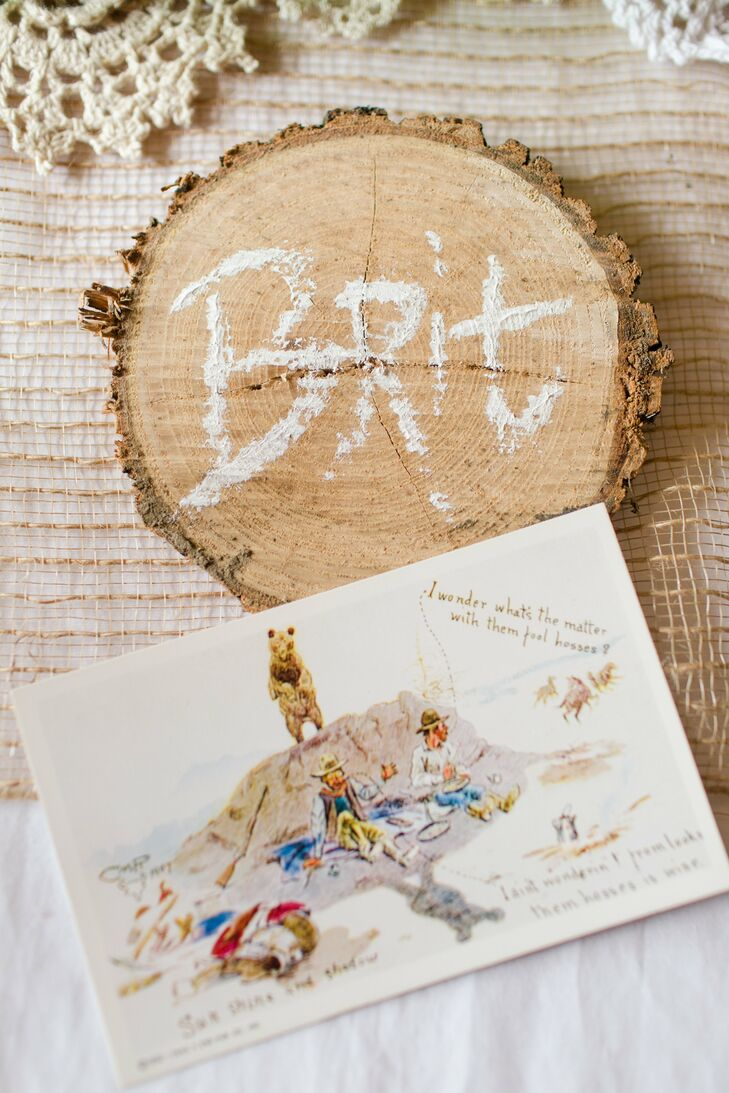 Guests found their seats through the circular wooden slabs that had their names written in white, bringing natural elements from outside straight into the indoor reception at the Barn & Gazebo in Salem, Ohio.