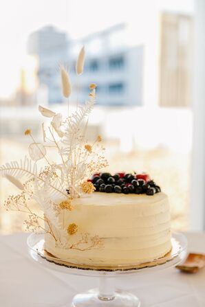 Single-Tier Wedding Cake with Feathers and Berries