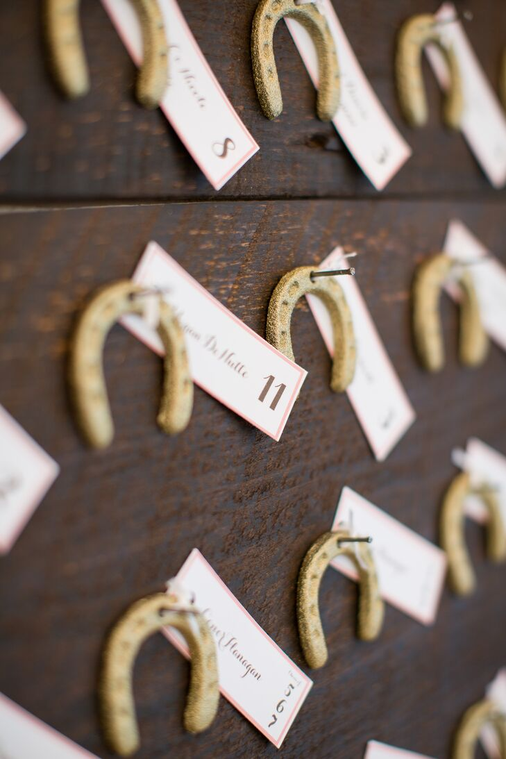 "Charming equestrian details were woven throughout the day, giving the elegant, romantic affair a touch of playfulness and personality. ""I'm a horse lover and grew up riding horses, so I knew I wanted to include some horsey elements here and there,"" Amy says. When guests arrived to the reception, they found the way to their seats with miniature horseshoe escort cards dusted with shimmery gold glitter."