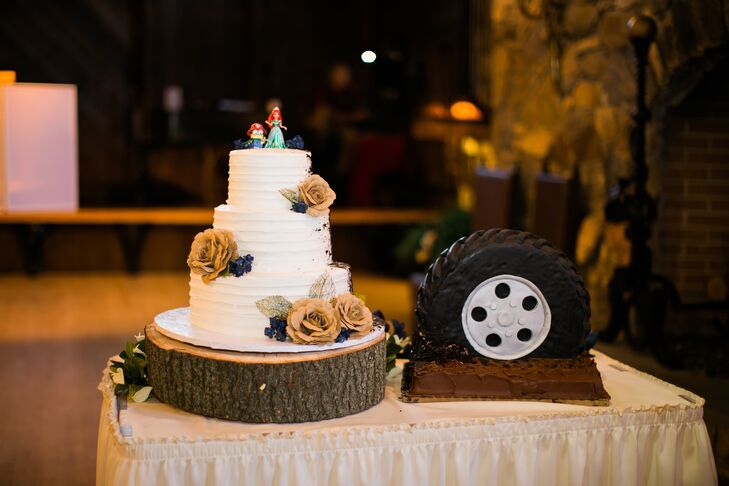 "Aubrey and Robert got creative with their cakes, opting for a wedding cake and groom's cake with playful, corresponding designs. The wedding cake was a three-tier confection with textured buttercream frosting, burlap roses and spattered chocolate on one side, which was meant to look like mud, a nod to the groom's cake, a tire stuck in mud. ""The tire was perfect and looked like it had spun in the chocolate mud to spatter onto the wedding cake,"" Aubrey says."