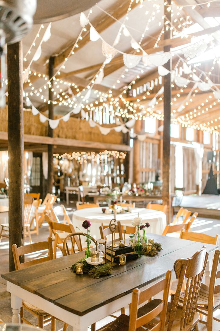 Rustic Reception with Hanging Decorations, String Lights and Mismatched Farm Tables