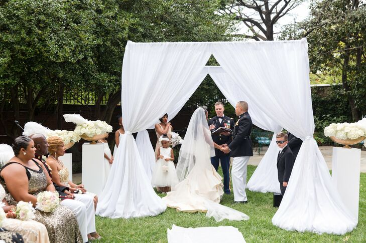 Outdoor Ceremony Under a White Fabric-Covered Altar