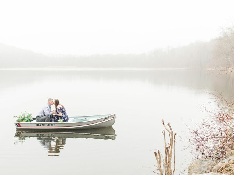 engagement photo shoot in a small boat on a lake