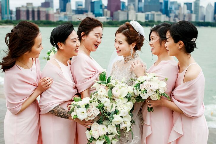 Modern Bridesmaids with Pink Dresses, Pink Shawls and White Bouquets