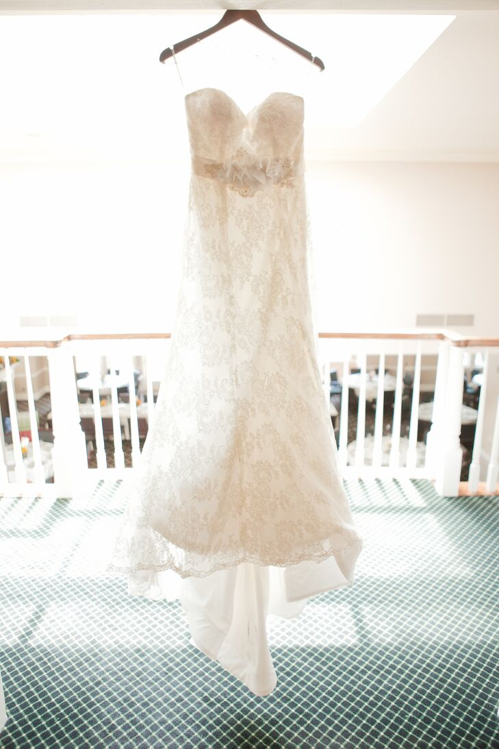 Katie wore an ivory elegant wedding dress, with a top layer of lace decorated with a belt.