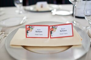 White and Red Escort Cards on Plate