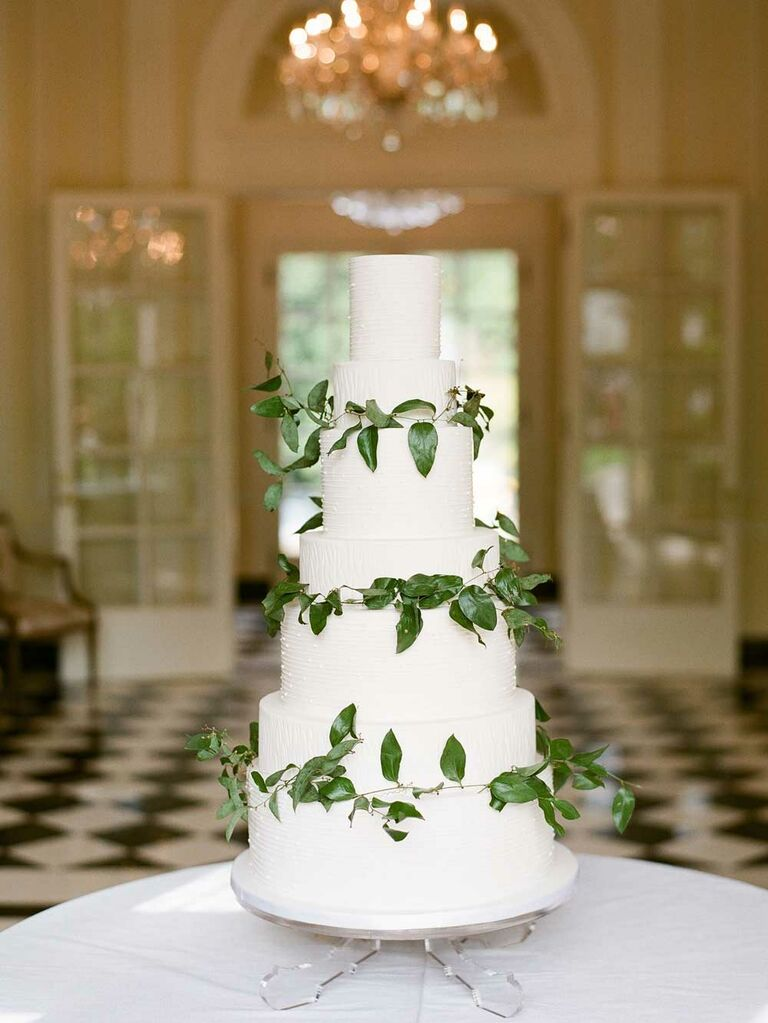 White wedding cake with green leaf garlands