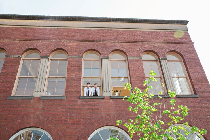 Jason and Jason leaned outside the window of their brick venue, Yale Union.
